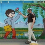 Shahrokh walking by a kindergarten.